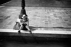 At the edge of the canal (Just Ard) Tags: street venice people blackandwhite bw woman blancoynegro monochrome person photography reading mono nikon noiretblanc zwartwit map candid d750 unposed  biancoenero canalside 24120mm schwarzundweis justard