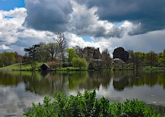 Sherborne Castle (john atte kiln) Tags: trees england sky lake castle clouds reflections spring raleigh tudor foliage dorset mansion bushes digby sherborne 16thcentury sirwalterraleigh hillock sherbornecastle walterraleigh digbyestate