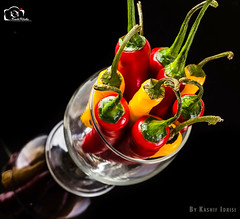 The Chili Peppers! (Kashi Klicks) Tags: red stilllife food hot art nature glass yellow pepper healthy chili artistic eating spice vegetable indoors thai bunch kashi hotstuff kk freshness ingredient foodphotography klicks kklicks kashiklicks