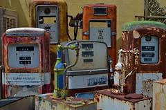 Decommissioned (MPnormaleye) Tags: metal 35mm junk mechanical retro gas pump rusted utata junkyard meter petrol gasoline refuse