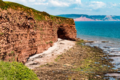 Cave at Poolness Beach (Keith in Exeter) Tags: uk red sea england cliff beach rock landscape coast sand europe outdoor devon gb cave lowtide tidal budleighsalterton otterton poolness brandyhead