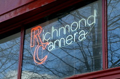 RichmondCamera (T's PL) Tags: virginia nikon neon va neonsign stg richmondva shotthruglass richmondcamera d7000 tamron18270 nikond7000 tamron18270f3563diiivcpzd