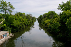 RIver Travel (BradPerkins) Tags: trees reflection water lines river murky urbanlandscape brownwater