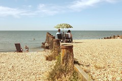 Sunny Outlook (geedub611) Tags: sea sky seascape beach shoreline shore parasol groyne