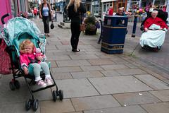 Two People Waiting (stevedexteruk) Tags: child buggy pushchair wheelchair young old disability 2016 wales street life