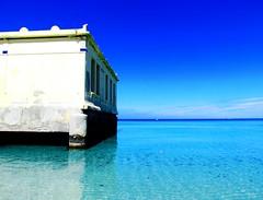 the harmonious unity of the sky and the sea (aannasole) Tags: sea sky italy sun beach water clouds boats restaurant sand charleston sicily sicilia mondello