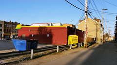 Alley behind the convenience store (real00) Tags: city blue red urban yellow dumpster landscape alley pittsburgh pennsylvania trashbin goldenhour conveniencestore urbanlandscape westernpennsylvania 2000s 2016 alleghenycounty 2010s pittsburghregion willreal williamreal