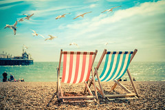 sea view (gian_tg) Tags: sea summer sky seagulls holiday beach landscape seaside pebbles deckchairs brightonpier brightonuk 7dwf