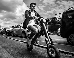 Street - Driving (Franois Escriva) Tags: street blue light sky people bw sun white man black paris france bike bicycle clouds drive weird photo noir driving candid streetphotography olympus rue blanc omd
