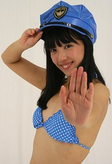 Police Pauses Pool Party. (emotiroi auranaut) Tags: blue woman beautiful beauty smile hat smiling japan lady female asian japanese asia hand gorgeous police palm bikini cop attractive policewoman grin grinning fetching