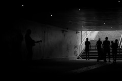 Just until I feel this misery is gone (Thomas Demeulemeester) Tags: summer people bw musician music woman men byn monochrome stairs subway day child stroller silhouettes tunnel graffity misery guitarist backlighting bucarest blackwandwhite