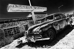 Cow Canyon Trading Post (garylestrangephotography) Tags: garylestrangephotography utah usa bluff travelphotography car buick america motorcar black white grey monochrome monotone mono outside outdoor blackandwhite vehicle automobile drive roadtrip road highcontrast