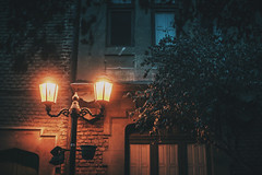 Luces de Marzo (JavierAndrs) Tags: lmpara lamp luz light luces lights pared wall calle street vereda sidewalk casa house home hogar edificio building arquitectura architecture ventanas windows puerta door gate rboles trees hojas leaves ramas branches destellos glow naranja orange red rojo blue azul mezcla mix atardecer sunset explore explorar exploring explorando textura texture color colores colors atmsfera atmosphere ethereal mood moody santiagodechile chile viaje viajar travel trip nikon nikkor d800 50mm 14 f14