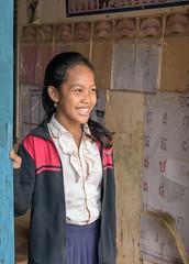 Laughing school girl (tmeallen) Tags: beautiful laughing cambodia classroom culture doorway schoolgirl schooluniform girlsschool peopleoftheworld kampongphluk schoolworkonwall