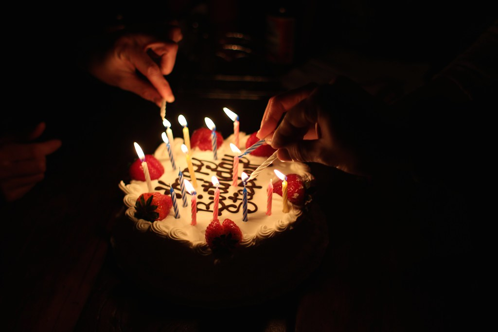 Steves Cake Candles Being Lit Olive Witch Tags Nyc Light Bar Night