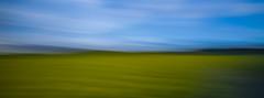 Windswept Landscape (Nigel Jones QGPP) Tags: sky blur field landscape motionblur pan incameramovement