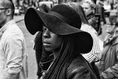 Hats - IMG_2074-Edit-2 (roger_thelwell) Tags: life street city uk winter portrait england people urban bw white black streets cold london lamp monochrome westminster beauty hat rain leather mobile umbrella hair bag walking real photography mono chat shiny phone traffic post natural photos britain circus cigarette candid cab taxi great sac hats cell photographic smoking lamppost photographs oxford conversation shiney talking shoulder handbag stud speak speaking studs commuters