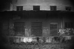 Abandoned Warehouse 9 (Chuck Baker) Tags: life camera white black love graveyard digital train canon germany lens photography death lomo lomography track ride nazi religion tracks poland graves plastic photograph alternative exterminate extermination