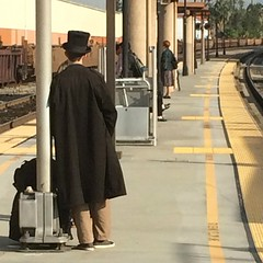 I'm  puttin' on my top hat, Tyin' up my white tie, Gettin' on the rails!   (Non Paratus) Tags: station train funny platform clothes amtrak tophat metrolink laist metroriderla