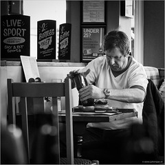 Slooowww... (John Riper) Tags: street uk england bw white signs man black monochrome liverpool canon john menu square table lunch photography mono bottle pub slow ketchup zwartwit candid angry l heinz 6d 24105 straatfotografie riper johnriper
