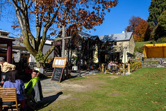 Enjoying the Sun (Jocey K) Tags: autumn trees newzealand sky people architecture buildings shadows chairs autumncolours tables southisland centralotago cafes arrowtown tripdownsouth