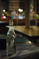 Lonely Water Bottle (Images by April) Tags: stilllife glass bottle f28 waterbottle glassbottle canont2i550dtamronf28