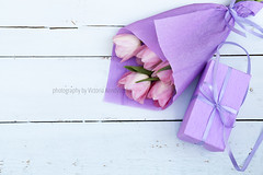 Beautiful bouquet of pink tulips in violet paper and gift on light wooden background (victoria.kondysenko) Tags: birthday wood pink wallpaper plant flower holland color green texture love nature floral beautiful beauty easter spring flora day pattern symbol anniversary decorative background space postcard mothers celebration card gift tulip bunch valentines florist bouquet greetings bud lovely delicate decor emotions copy springtime feelings advertise