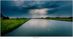 Towards the last light of the day (nandOOnline) Tags: light water clouds photoshop river landscape licht canal fuji hole nederland wolken swans kanaal maas gat meuse landschap rivier zwanen nbrabant keent xpro2