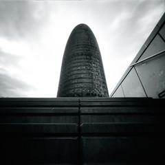 Sentinel (Dikal) Tags: barcelona blackandwhite bw tower 120 stairs skyscraper mediumformat square spain noiretblanc pavement nb pinhole 120film homemade squareformat mf rodinal espagne ilford fp4 zero2000 zeroimage agbar ilfordfp4 2016 25iso stnop zeroimage2000 dikal