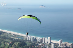 Paragliding - Rio de Janeiro (Totem REC - CLICK) Tags: ocean travel blue summer brazil sky man male beach nature sport rio danger de fun freedom fly flying high jump colorful janeiro lift wind action aviation air extreme flight wing free off hobby adventure landing take leisure recreation skydive paragliding activity soaring gliding glider paraglider hang soar active parachute glide