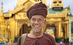 The smiling nomad of Shwedagon (Bn) Tags: myanmar birma burma yangon rangoon former capitol street candid monk bikes taxi city six million people buddhist temple botataung pagoda botahtaung gautama buddha hair 2500 years old religions locals 40m high seaport dazzling road car gold kyats umbrella sunshine entree hollow destroyed rebuild colonial overwhelmed infrastructure slums pilgrims buddism traffic cycling shwedagonpagoda 2600years 99m cars busy devotees prayer monks golden zedi daw great birds heaven earth pilgrim portrait nomad turban robes brown 100faves topf100