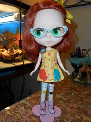 Gabbie received her new glasses in the mail today! I think they fit her colorful personality!!