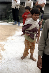 32-075 (ndpa / s. lundeen, archivist) Tags: winter girls people baby color fall film girl kids 35mm children infant village nick taiwan barefoot 1970s 1972 hualien 32 taiwanese carry carrying eastcoast dewolf onhisback republicofchina easterncoast onherback easterntaiwan nickdewolf photographbynickdewolf hualiencounty reel32