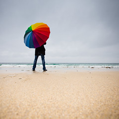 Thinking on the rain... (Zeeyolq Photography) Tags: alone beach bretagne colorful france lampaulplouarzel looking man nature ocean plages sand sea thinking umbrella