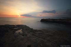 Sicilian sunset (Crupi Giorgio (official)) Tags: italia sicilia ragusa mare sole cielo scogliera nuvole tramonto panorama paesaggio canon canoneos7d sigma sigma1020 nd1000 italy sicily sea sun sky reef clouds sunset seascape relax