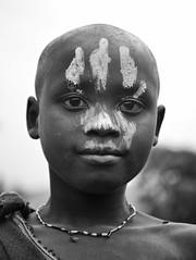 Surmi Boy, Tulgit, Ethiopia (Rod Waddington) Tags: africa boy blackandwhite face river town beads village african painted south traditional southern afrika omovalley ethiopia tribe ethnic surma ethnicity afrique ethiopian etiopia surmi tulgit