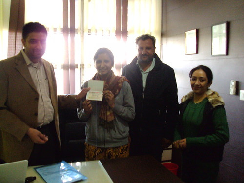 Amanpreet Kaur receiving Canada study visa from director
