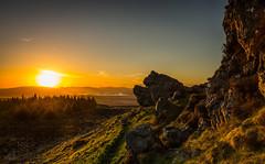 Loch Lomond from The Whangie (GenerationX) Tags: sunset sun mountains alexandria landscape evening scotland haze unitedkingdom dusk scottish neil hills rays benlomond trossachs balloch lochlomond barr kilpatrick auchineden whangie luss duncryne queensview inchcailloch arrocharalps inchlonaig inchmurrin
