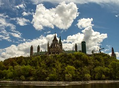 Clouds over Parliament Hill (Karen_Chappell) Tags: travel blue sky ontario canada green architecture clouds landscape cityscape cloudy ottawa parliamenthill