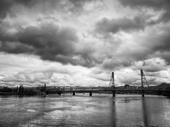 Portland Rain (idreamofdaylight) Tags: city bridge blackandwhite bw usa white storm black rain clouds river portland lumix cloudy panasonic handheld oregeon 2016 mft streetsofportland dmcgx7