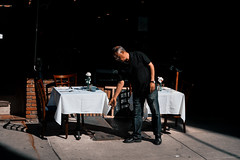 Stage (reinfected) Tags: street new york city nyc people italy ny man cup glass work table outside person photography restaurant photo chair play little metro manhattan candid stage fine area dining metropolis worker dine cloth seating owner