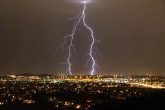 Desert Monsoon Lightning (Steven Kuipers) Tags: arizona storm phoenix night monsoon citylights bolt nightsky lightning lightningstrike