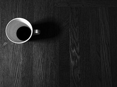 Coffee cup and shadow (Randy Weiner Photography) Tags: blackandwhitephoto coffeecup woodfloor woodgrain white black coffee texture grain distresswoodfloor bw stilllifeisolation detail