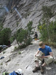 reading at the crag (squeezemonkey) Tags: portrait rock outdoors spain readingbook limestone catalunya climber crag sportsclimbing collegats elniusector
