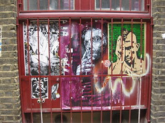 Faces behind bars (Niecieden) Tags: red green london pasteup face june stencil bars shoreditch travisbickle 2010 c215 toxicomano paullechien canondigitalixus90is christianguermy
