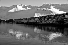 living on a Northern edge (lunaryuna) Tags: bw seascape water monochrome reflections season landscape coast blackwhite iceland spring fjord ripples lunaryuna seeingdouble westfjords mountainrange snowcappedmountains viillage seasonalchange northwesticeland stillstuckinwinter