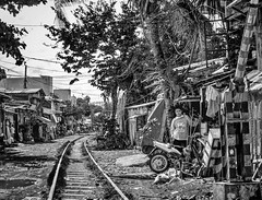 Living along the tracks (FotoGrazio) Tags: poverty people blackandwhite painterly art texture composition contrast asian photography photoshoot fineart philippines poor streetphotography highcontrast streetportrait streetscene filipino moment photographicart capture bicol pinoy digitalphotography legaspi railroadtracks albay phototopainting phototoart legaspicity sandiegophotographer artofphotography flickrelite californiaphotographer internationalphotographers worldphotographer livingbythetracks photographersinsandiego fotograzio photographersincalifornia waynegrazio waynesgrazio