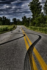 Streets of Murica (Douglas Perkins) Tags: road summer clouds grunge stormy tiretracks yellowline burnedrubber