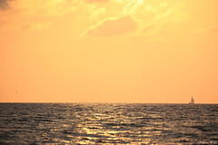 Sailing off  into the sunset (fusk4) Tags: ocean sunset sea sol beach canon landscape boat mar barco florida sail fl
