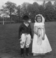 The wedding photo (theirhistory) Tags: trees boy girl field children bride dress post jacket dressingup flagpole runner rider wellies headdress breeches ridingboots